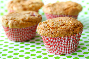 Rhubarb muffins freshly baked in red cups