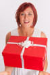 Red haired girl catching a present