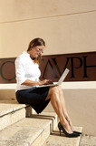Wireless working businesswoman outdoor