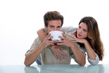 Couple with large bowl of coffee