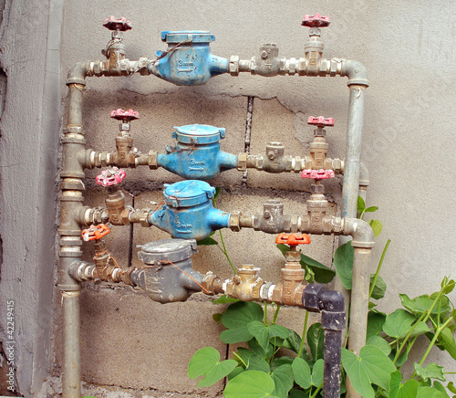 old rusty  water pipe, meter and valve