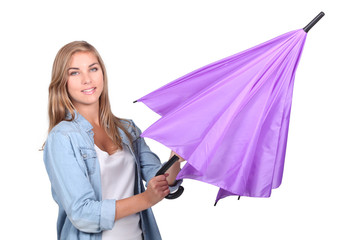 Young woman opening an umbrella
