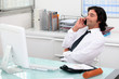 Businessman using a phone at his desk