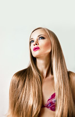 looking up a beautiful young blonde girl with long hair