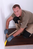 A man laying parquet.