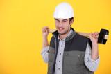 Tradesman carrying a mallet
