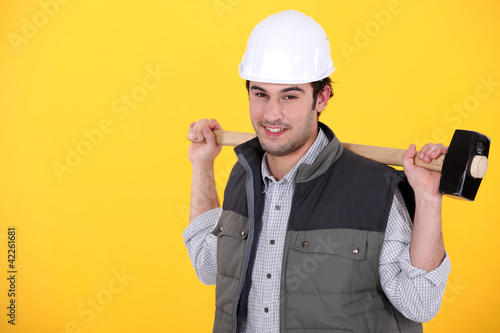 Tradesman carrying a mallet