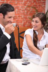 Couple with laptop in restaurant