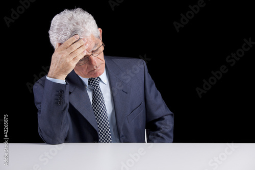 Headache on a senior businessman