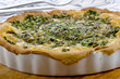 spinach quiche in a porcelain baking form