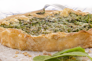 spinach quiche and some fresh spinach