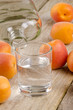 fruit brandy in a glass and fresh apricots