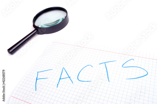 Facts and hand magnifier