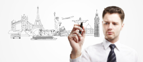 businessman draws architectural buildings