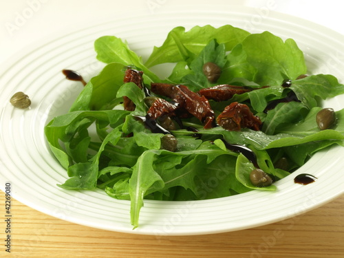 Arugula with sun dried tomatoes