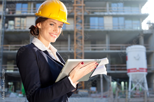 Female construction engineer / architect with a tablet computer