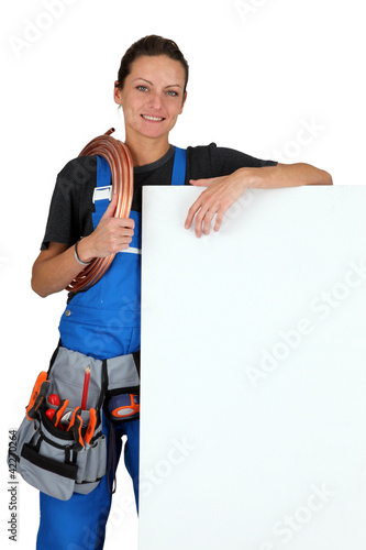 Brunette labourer with message board