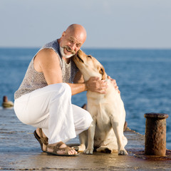Man of middle age with dog
