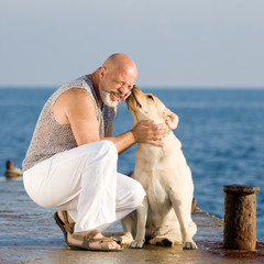 Middle-aged man with labrador dog