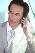Mature businessman using a cellphone