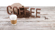 Disposable cup of coffee over vintage wood background with space