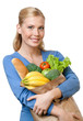 Young woman with a paper bag full of healthy food