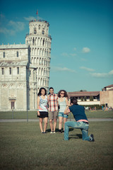 Group of Friends Taking Photos, Pisa Leaning Tower on Background