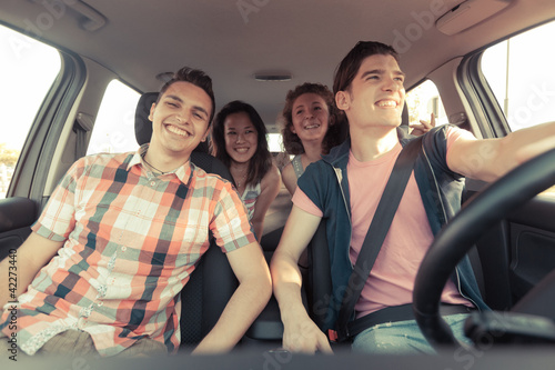 Four Friends in a Car Leaving For Vacation