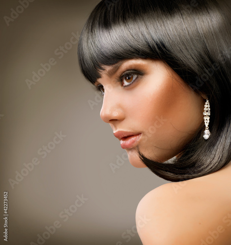 Beautiful Brunette Girl. Haircut. Hairstyle