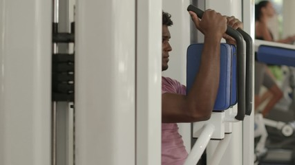 Sport, young black man training in fitness gym