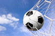 close-up of a soccer ball (football) going into the back of the