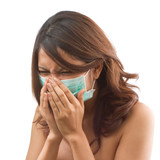 SICK WOMAN sneezing with epidemic protective mask