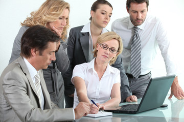 Businessteam around a laptop