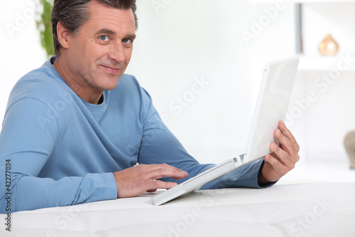 Man with computer inclined