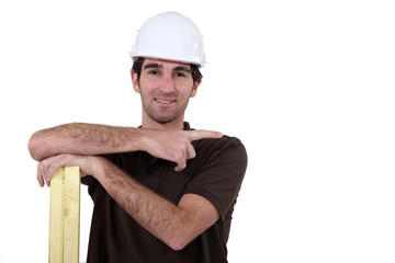 Carpenter pointing to empty copyspace