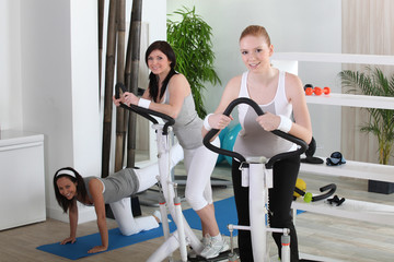 Young women using gym equipment