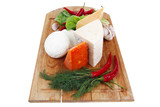 french cheese on wooden board with hot peppers