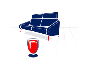 Soft sofa and glass of red wine
