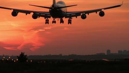 Jumbojet landing at dusk