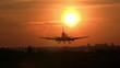 Big plane landing at sunrise