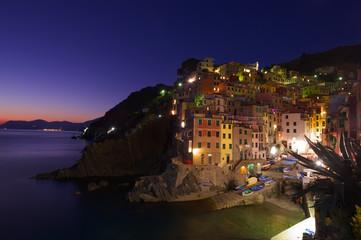 village at night on sea side