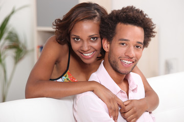African couple relaxing at home