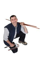Man bending copper tubes