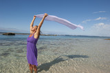 Happy and serene woman at beach vacation poster