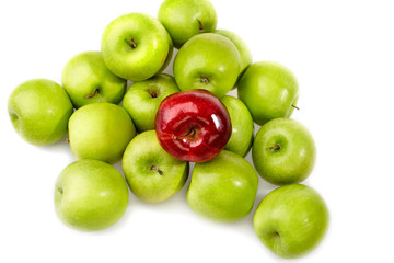 red apple between green apples
