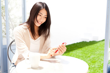 a young asian woman relaxing in the cafe