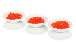 Red caviar in white bowls isolated on white