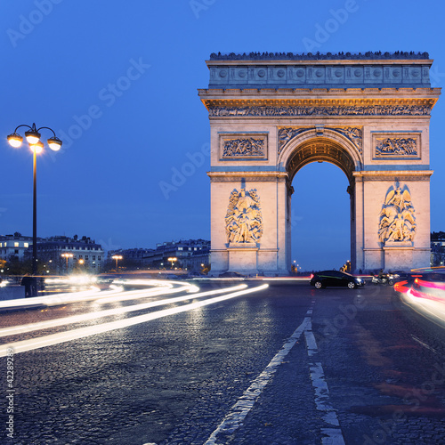 famous Arc de Triomphe by night