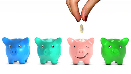 Woman's hand choosing a piggy bank and giving it a coin