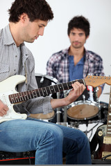 young men playing music